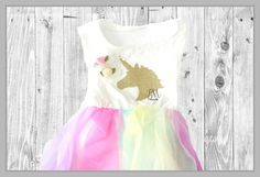 ***PLEASE NOTE*** current order processing time is 1-3 weeks. If you need your order urgently or by a certain date, please send me a message before placing your order. Thank you!  ~♥~♥~♥~♥~♥~♥~♥~♥~♥~♥~♥~♥~  Gorgeous colourful dress, great for a 1st birthday party or cake smash photo shoot!  ♥ This listing is for a Pastel Rainbow & Gold Glitter Unicorn Birthday Dress.  **Please make sure to read the size chart before purchasing**  ~♥~♥~♥~♥~♥~♥~♥~♥~♥~♥~♥~♥~  Due to monitor & computer&#x...
