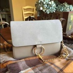 Gray crossbody Brand new with dust bag. Price is firm. This bag is really gorgeous. Gray with gold details. Not ASOS. Next day ship. Also available in brown in my closet. ASOS Bags Crossbody Bags