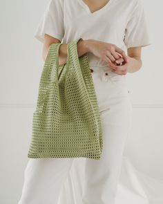 """Baggu's signature shape made from a chunky net fabric. Comes with a × expandable canvas pouch to keep your essentials secure. Mid-sized for hand carrying. DIM's 20 ½"""" × 12 ½"""" × 5 ½"""" polyester Machine wash cold, line dry. Diy Bags Purses, Net Bag, Ideias Diy, Fabric Bags, Fabric Basket, Shopper Tote, Knitted Bags, Fashion Bags, Diy Fashion"""