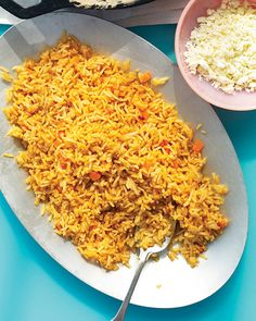 """One cook's """"Spanish"""" rice is another's """"Mexican."""" Whatever the name, the result is more or less the same: an orange pilaf-style rice flavored with onion and garlic and flecked with carrot. Tomato paste further tints this colorful companion to all things Tex-Mex."""