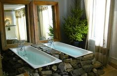 The serenity of an outdoor bath is reflected in this unique bathing space. Natural stones boost the twin baths, rustic mirrors reflect light into the room, and classic bath fittings add charm. By Catherine Painvin, Aubrac, France Guesthouse Hotels In France, Log Cabin Living, Classic Baths, Lakeside Cottage, Lodge Decor, Elegant Homes, Style At Home, Future House, Rustic Decor