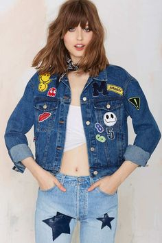Patches on a jacket and jeans