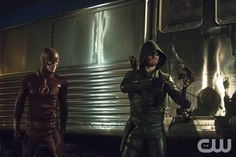 """Arrow -- """"The Brave and the Bold"""" -- Image AR308a_0170b -- Pictured (L-R): Grant Gustin as The Flash and Stephen Amell as The Arrow -- Photo: Cate Cameron/The CW -- © 2014 The CW Network, LLC. All Rights Reserved.pn"""
