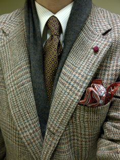 It's fall. Out with the light colors and fabrics of Spring and Summer; in with the textures and layers of fall and winter. Scarf, sport jacket, nice pocket square, white shirt (crisp) tie and a color knot for interest. Well done.
