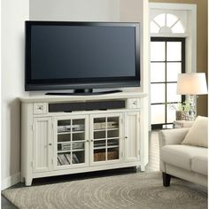Features: -Tidewater collection. -Material: Poplar solids and birch veneers. -Style: Modern country. -Shade color: Off white. Design: -Corner unit. Product Type: -TV Stand. Finish: -Vintage whi