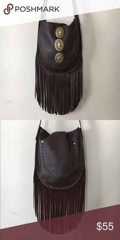 Handmade Brown Leather Concho Fringe Purse Handmade Brown leather fringe bag with brass conchos. 1 inside pocket and 1 outside pocket. This purse is handmade by me. It's one of my samples used for photo shoots and has been used only a few times. I don't make this style anymore so I'm selling off my oldies! 9 inches wide 10 inches tall 8 inches of fringe 32 inch strap Free People tag for exposure. Free People Bags Shoulder Bags