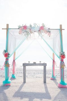 Beach, Waterfront Wedding Ceremony with Bamboo Altar and Pink and Teal Floral and Draping Accent Details     St. Pete Beach Wedding Planners Tide the Knot Beach Weddings