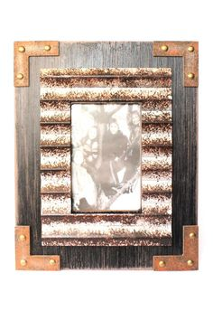 Rustic wood and metal frame is a great addition to your home! Makes a great gift!  Holds a 4 x 6 photo;Approximate measurements 9.5 x 12 x .5  Wood & Metal Frame by Youngs. Home & Gifts - Home Decor - Frames Iowa