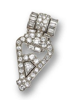 ART DECO DIAMOND CLIP-BROOCH, CARTIER, LONDON, 1929. The openwork arrow-shaped clip pavé-set throughout with old European-cut diamonds, decorated further with 18 baguette diamonds and 1 kite-shaped diamond, altogether weighing approximately 4.70 carats, mounted in platinum and 18 karat white gold, numbered 7636. With original signed box.