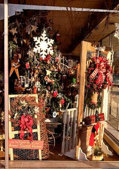 New front Christmas window display wreaths snowmen and oh so much more!