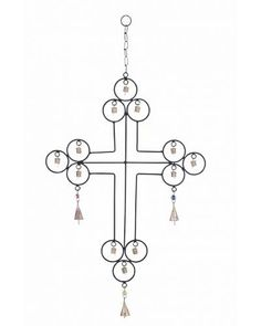 Metal Wind Chime with Cross Design and Rustic Bells - features an eclectic cross-themed look. Look at it from the religious point of view, or just with the eye of an artist, this wind chime is a sure attention grabber. With astute symmetry in its craftsmanship, it is sure to spark up some interesting conversations while adding an irresistible rustic charm to your space.
