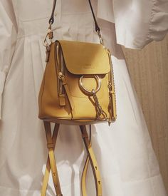 From @chloe Experience international luxury FOLLOW US. Sunshine ready  our Spring 2017 collection introduces the mini Faye backpack in a saturated dusty yellow  Step into the sun on chloe.com