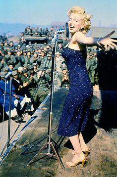 1954: Marilyn Monroe singing to the troops in Korea, photographed by Herb Helpingstine
