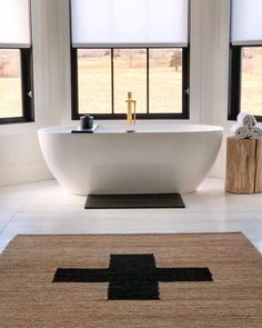 The ultimate feel good space, achieved. Get the look at theshadestore.com // Design by DesignByDad Freestanding Tub, Bathroom Windows, Positive Vibes Only, Roller Shades, Design Consultant, Beautiful Bathrooms, Window Treatments, Blinds, Swatch