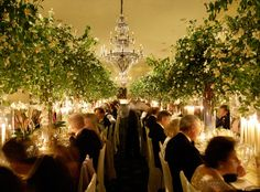 Rent trees for the reception...not as center pieces but to soften the hangar.