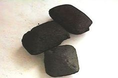 "Just like a charcoal water filter, charcoal briquettes can be used to absorb moisture and odor from the air in your home. A while back, Gregory tipped us off on using charcoal to remove fridge odors, but they definitely work in other rooms, too. We've found them particularly helpful for ""old apartment smell"" if you're in an old building or moist smells in basement-level units."