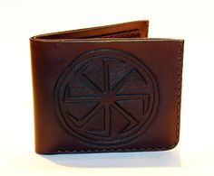 Leather wallet with Kolovrat.  The kolovrat [spinning wheel] represents the Sun…