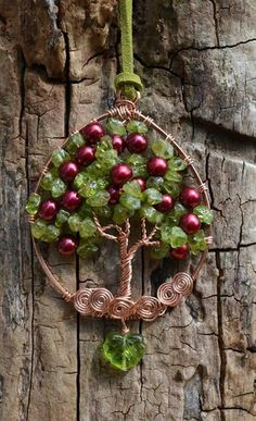 Such a lovely pendant, it looks like an apple tree. Love this