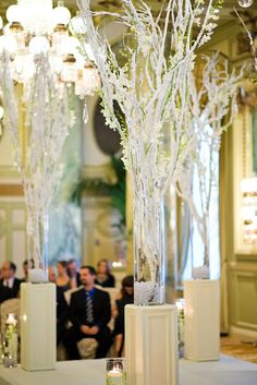 Frosted branches make such elegant decor for a winter wedding
