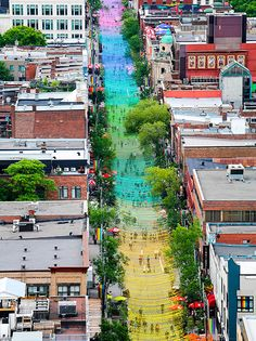 claude cormier + associés installation above st. catherine's street, in montréal, québec, uses resin balls in eighteen hues of vibrant colors for his 2017 work titled,'18 shades of gay.' Such an ambitious, visually arresting, well-thought out concept. And undeniably beautiful!