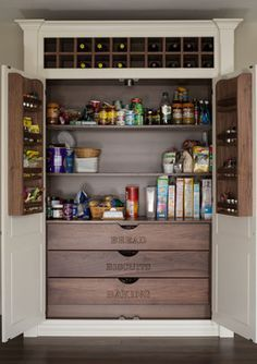 Don't you just love this built-in pantry with its labeled wood drawers? The wine rack at the top is a nice touch, too. http://www.town-n-country-living.com/kitchen-pantry-ideas-for-your-home.html?utm_content=buffera623f&utm_medium=social&utm_source=pinterest.com&utm_campaign=buffer