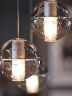 The low-voltage kitchen/dining chandelier features 14 cable-suspended pendants. Floating like raindrops, each articulated cast-glass sphere holds an LED lamp.  #HGTVUrbanOasis  http://www.hgtv.com/urban-oasis/hgtv-urban-oasis-2013-kitchen-pictures/pictures/page-21.html?soc=pinterest