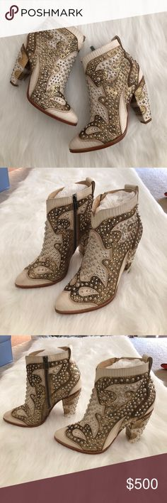 """NIB {frye} remy deco bootie Brand new with box! Almond toe. 4"""" heel. Off white leather with crackled metallic gold western style design. Off white aged studs. I love these so much. I bought them for Vegas but didn't end up wearing them  I want them to go to a good home where these beauties will be shown off the way they should be! Comes from a smoke-free home!! Price firm!! NO trades. NO ️️. LOWBALL OFFERS will NOT be tolerated! I love bundles though  Frye Shoes Heeled Boots"""
