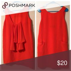 """✨LastChanceFinal$✨ark & co. Coral Tunic Dress Coral tunic dress from ark & co. with a scoop-neck hem in the front and back. Back neckline is lower than front and has decorative ruffle trim. Two pockets, one on each side of front. Item is in excellent condition with no obvious wear or flaws. Size Medium. Measurements: Bust 19.5"""" (flat, armpit to armpit) Length 34"""" Length from Front Bottom Neckline 30"""" Length from Back Bottom Neckline 22"""". Bundle to save $$$. Happy Poshing! 🙂 Ark & Co Dresses…"""