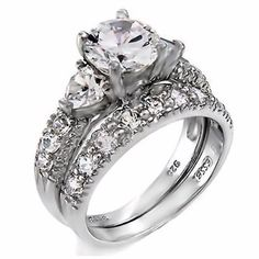 Oliana: 4.12ct Ice on Fire CZ & Heart accents 2 pc Wedding Ring Set 925 Silver, 3035B sz 7.0 1000 Jewels http://www.amazon.com/dp/B00J9GAQGE/ref=cm_sw_r_pi_dp_BR82vb0X96K31