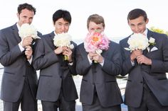Don't take wedding formals too seriously.  Here is the groom with his groomsmen having fun with the girls' flowers.  A Dreamy Viking Love Story: Lauren and Erikk's Wedding at the Duxbury Bay Maritime School » Fucci's Photos of Boston–Something Blue Blog | Boston Wedding Photographer