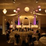 Purple and Lavendar Wedding- Lighted  Dance Canopy with lavendar and white lanterns and lavendar uplights.  The head table is under lighted and decorated with white tulle.  The table covers are white and the sashes are dark purple satin.  Maneeley's in South Windsor
