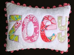 I like this idea...take favorite baby outfits, cut letters from the baby's name, sew onto a baby blanket and use the blanket to make a pillow