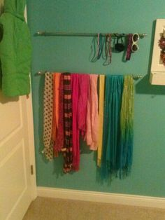 Use cheap curtain rods to display and organize scarfs, headbands and belts.  I used two and screwed them behind the door so its out of sight when the door is open.  A great way to remember to accessorize everyday. Teens bedroom organize.