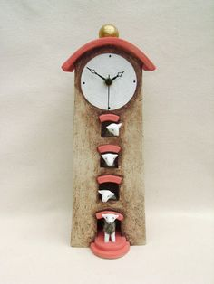 Ceramics by Helen Hargreaves at Studiopottery.co.uk - 2013. Clock - tall with sheep in door & windows (curved roof)