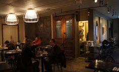 seattle cafe pettirosso architecture design restaurant modern salvaged lights reused door #SeattleArchitecture #SeattleArchitect #Architect #Seattle