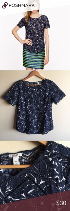 """J. Crew printed eyelet top in navy blue Beautiful top in excellent condition, like new! Measures 19"""" from underarm to underarm and 25"""" long. """"Inspired by one of our flower prints, Grace (our in-house graphic guru) printed it over an eyelet top to create a modern take on florals. Finished with scalloped trim, it's a wear-everywhere mix of relaxed and refined."""" * Cotton. * Import. * Item03413. J. Crew Tops"""