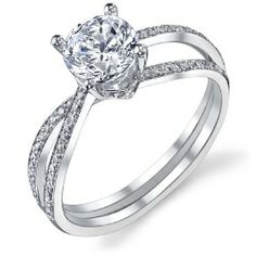 This engagement ring features a twist ring body with pave set diamonds spanning halfway down both shanks (0.23ctw).