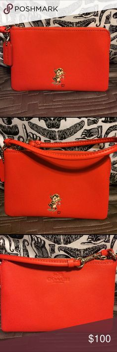 Coach Beast Baseman Red Wristlet Very cute wristlet featuring a monster. In perfect condition. Measures 6 1/2 x 4. Coach Bags Clutches & Wristlets