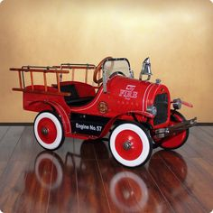 Raise the Fire Alarm! Your little fire fighter can come to the rescue in their very own Fire Truck Roadster Pedal Car. The flaming red fire truck comes with a full line of features including a fully f