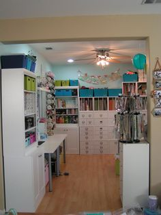 ok -- my dream room -- now all I need is a ladder to get to the top --  A Tour of A Scraproom -- I love this room. It's very narrow but the designer worked really well with that. The trick is, in a small room, to build up and not out. Maximize your space!  from Jennifer Priest at Hydrangea Hippo