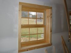Natural Horizontal Knotty Pine Paneling on window wall Cabin