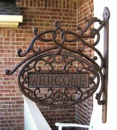 """""""Cast Iron hanging metal welcome plaque - eBay - Farmhouse Temptations""""    That's another thing I love--cast iron!"""