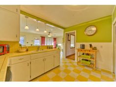 Colorful lime green and lemon yellow kitchen in this in this Austin, TX home