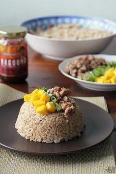 "Special fried rice made the Filipino way-- with bagoong, bits of ""pork binagoongan"", scallions, and green mangoes! Recipe on the blog. :)"