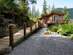 The Perch experience starts with a ramp bordered by moss and lichen and views of the gardens and Oyster Bay and Mt. Gardens, Cabin, House Styles, Building, Plants, Cabins, Buildings, Garden, Flora
