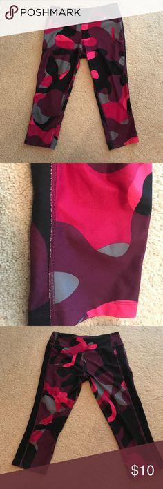 Nike Pink Camo Capris Slight wear. 88% polyester/12% Spandex Nike Pants Leggings