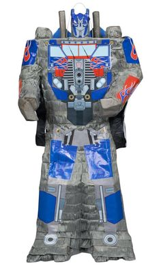 """Transformers 3D Pull String Pinata Includes: (1) themed 25"""" X 13"""" X 7"""" pull-string pinata. Does not include favors or fillers. An addtional shipping and handling fee of $5 applies to this oversized it"""