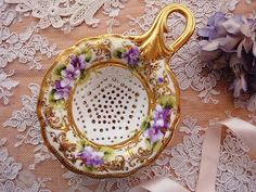 Porcelain tea strainer.