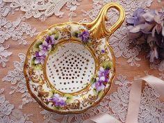 violets on a tea strainer