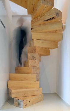 The wooden blocks that make up this spiraling staircase are so chunky that it looks like you'd have to climb up on tiptoe.   - ELLEDecor.com